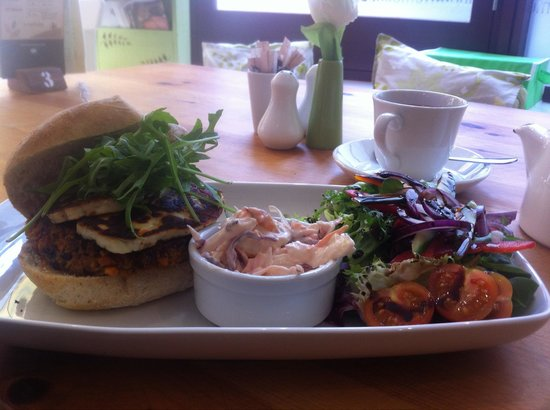 Green Leaf Cafe Torquay: Vege burger topped with grilled halloumi in a ciabatta bun with balsamic drizzled salad and home