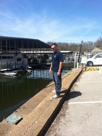 Lodge of  Four Seasons: The slips at the marina...property was pretty.  Oh, that's my hubby too;)