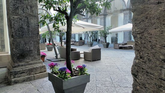 Palazzo Caracciolo Napoli MGallery by Sofitel: One of the delightful courtyards - a haven of peace