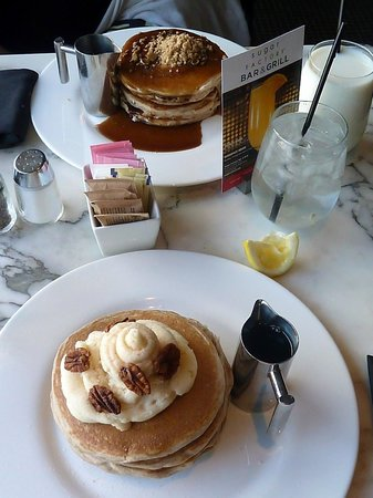 The Sugar Factory: Our breakfast of carrot cake pancakes (front) and cinnamin apple stuesal pancakes