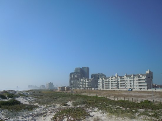 Aquarius Luxury Suites: View to the complex from the beach