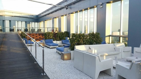 Novotel Barcelona City : Top of the roof with swimming pool,  bar,  and fitness amenities.  A gem!