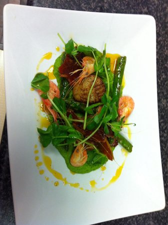 Salt Marsh Kitchen: Dive caught pan fried scallops with pea purée, pea shoots, Parma ham shards prawns and saffron o