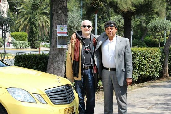 George's Taxi : Michael and I in front of his car...