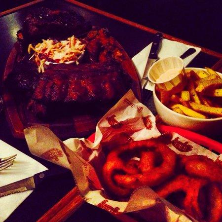 Bodean's BBQ - Soho: Boss Hog Platter, Onion Rings, and Fries!