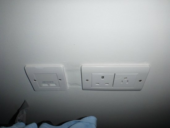 Sandals LaSource Grenada Resort and Spa: USB power connector and 110 plug next to bed