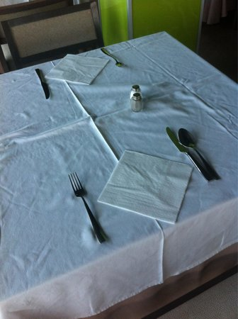 Hotel  Arenas del Mar: Table setting for breakfast and lunch. Evening meal gets an extra spoon. So classy.