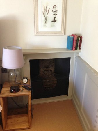 The Porch House: fireplace