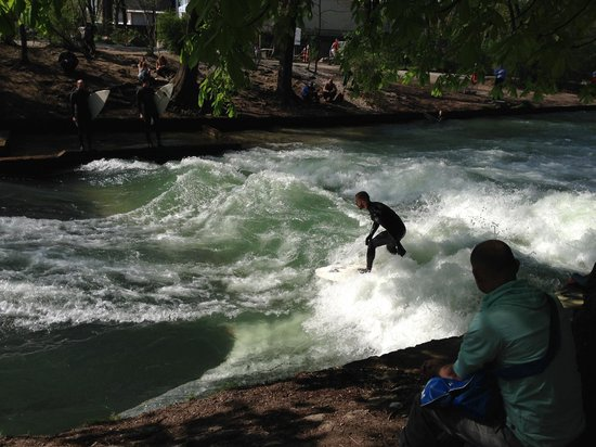 Mike's Bike Tours: surfers in the river
