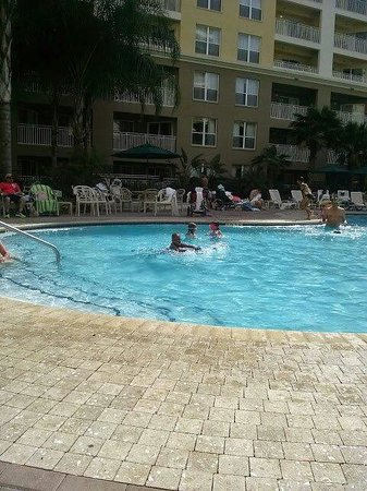 Vacation Village at Parkway: Jacuzzi is to the left under the tree..no sun