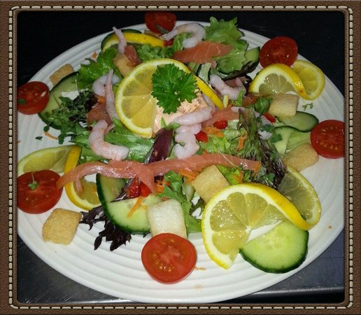 forest edge cafe and teahouse: seafood salad with smoked salmon on a bed of crispy leaves.