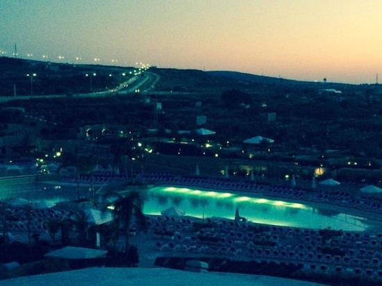 db Seabank Resort + Spa: Lovely view pool side at night.