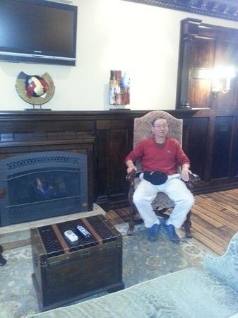 Hydrangea House Inn: Husband Sitting next to the fireplace in our room.