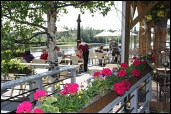 Pump House Restaurant & Saloon: Flowers on the Pump House deck during summer.