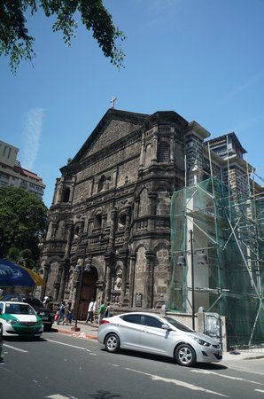 Malate Church : Facade, with renovation works on the right side