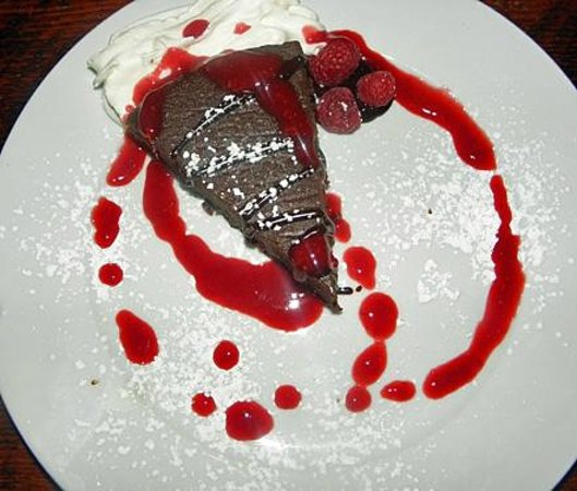 The Timberhouse Restaurant: Chocolate decadence flourless chocolate cake topped with genache, raspberry puree