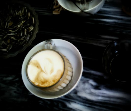 Giang Cafe : Delicious creamy hot egg coffee vs. some time killing sunflower seeds
