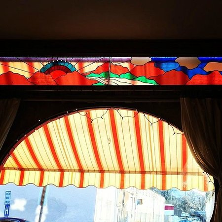 Whole In the Wall: The pretty stained glass window and awning.