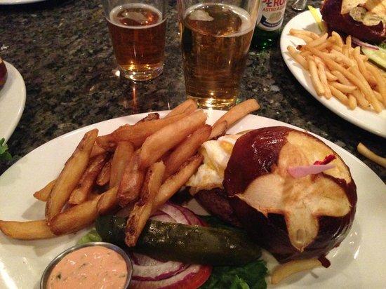 Burger Bar : Pretzel bun burger with fat fries and hangover sauce on the side