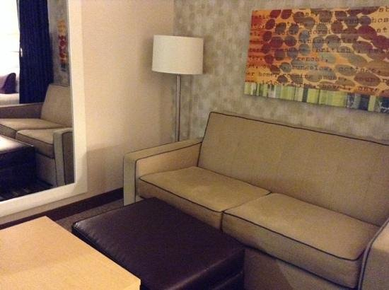 Home2 Suites by Hilton Philadelphia - Convention Center, PA: Tiny sitting room with a fabric divider to separate from bedroom.