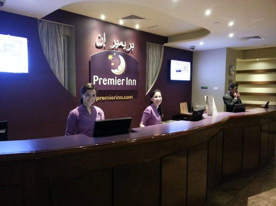 Premier Inn Dubai Silicon Oasis Hotel : Premier inn reception with Miss. Chaima (the first young lady)