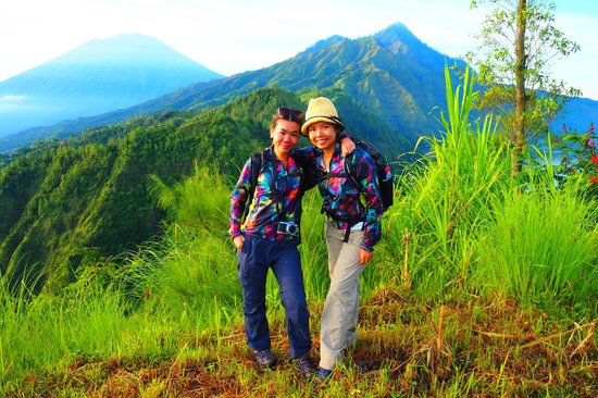 Bali Trekking Tour - Day Tours: 2 happy ladies with mount Abang & Agung background