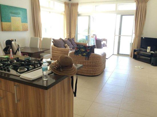 Cohiba Villas : living room from kitchen looking to balcony