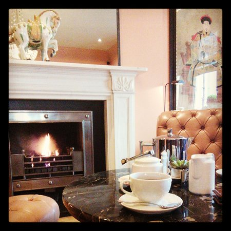 The Kensington: tea by the fireplace