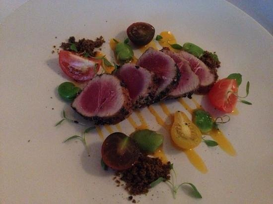 ... Seared tuna with heirloom tomatoes, egg yolk dressing and olive crumb