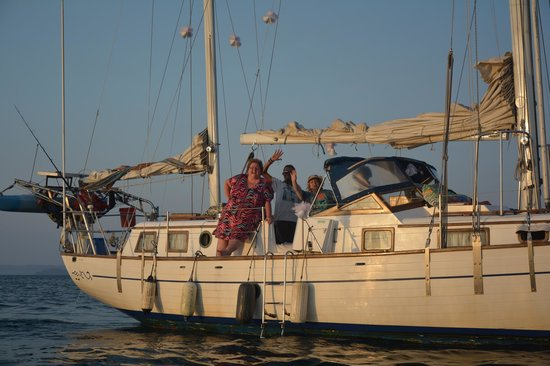 Sea Bird Sailing Excursions : Brides and Captain Sebastian waving goodbye to the grooms