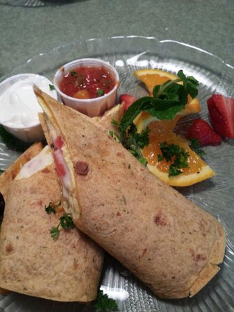 Wildflower Cafe: Breakfast burrito with tomatoes, bacon, cheddar & fruit salsa.