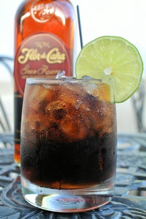 Bocadillos - Tapas Kitchen & Bar: Nica Libre - Flor De Cana Gran Reserva, Coca Cola & Lime.