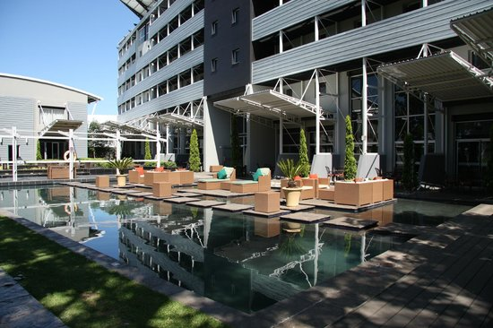 Protea Hotel by Marriott OR Tambo Airport: Inviting Pool Surrounded by Various Sitting Areas