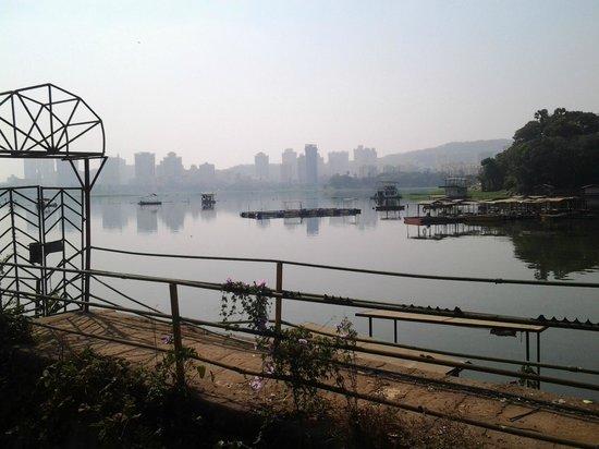View of Powai Lake with Mumbai Skyline from Powai Gardens
