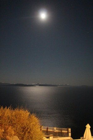 Floga: A view of the caldera from our table with the moon and stars.