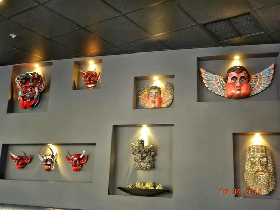 Cafe Poca Cosa : Collection of masks on wall