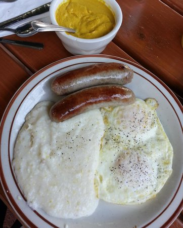 Cypress Nook Bavaria Haus Restaurant: Brats, grits and over medium eggs