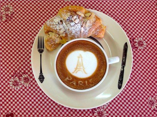 Le Cafe de Paris: Your Flat White and your almond croissant