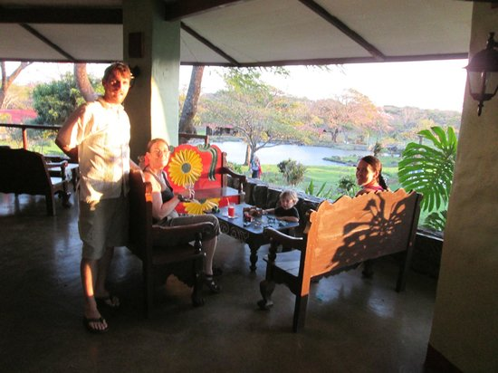 """Rincon de la Vieja Lodge: this is the open-sided gazebo """"bar"""" outdoor dining area.  sunset!"""