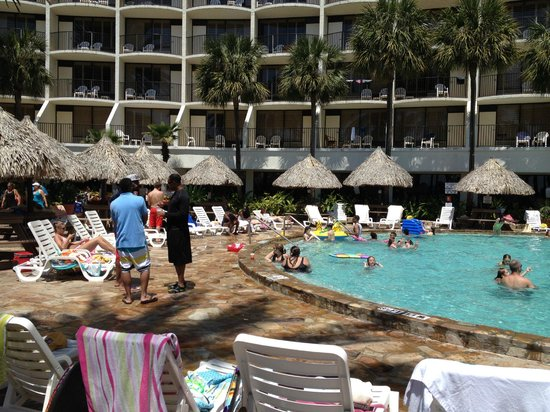 Holiday Inn Resort Panama City Beach : pool area with tiki picnic tables