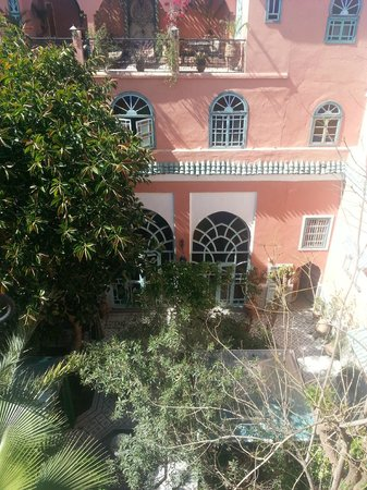 Riad Catalina: View of courtyard from above: Beneath the canopy are dining and seating areas to enjoy a drink/m