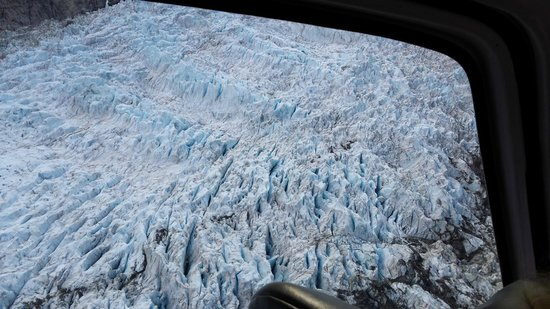 Fox Glacier Guiding: First peek at the glacier from the helicopter