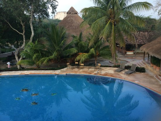 The Lodge at Uxmal: Pool and Restaurant (In distance is Uxmal)