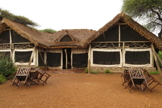 Serengeti Tented Camp - Ikoma Bush Camp: Restaurant early eveing with the external ntes down to stop insects