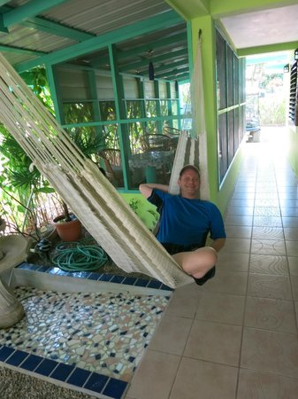 Casa Placencia Belize : Phil chillin in the hammock by the beautiful mosaics that Jacki did herself.