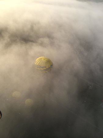 Balloons Above the Valley: Just Launching and other balloon through mist