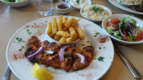 Taste Of Cyprus: Chicken kebab with hot crispy chips, seasoned rice and a fresh crisp salad.
