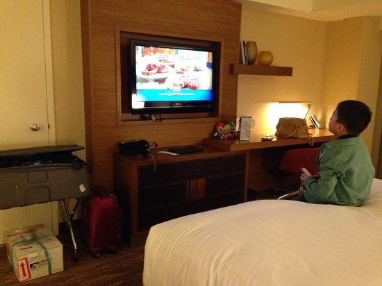 Grand Hyatt San Francisco : My son tinkering with the TV. You can see guest folio, room service, movies on demand, etc
