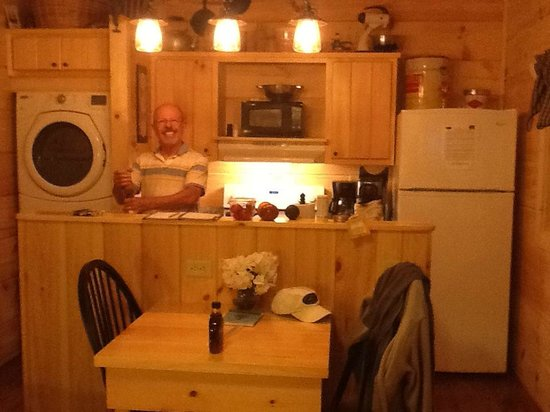 Cabins of Asheville : Nicely stocked kitchen with dishes, silverware, pots, pans, wine glasses, and beer mugs