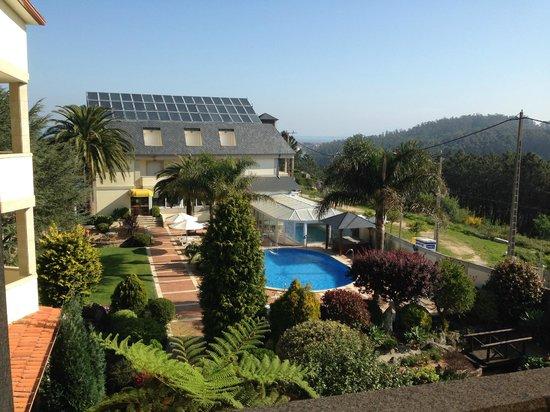 Hotel Bosque-mar: jardines y piscinas desde la habitacion